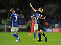 Referee Jarred Gillett shows Cardiff City's Joe Bennett the yellow card <br /> <br /> Photographer Ian Cook/CameraSport<br /> <br /> The EFL Sky Bet Championship - Cardiff City v Huddersfield Town - Wednesday August 21st 2019 - Cardiff City Stadium - Cardiff<br /> <br /> World Copyright © 2019 CameraSport. All rights reserved. 43 Linden Ave. Countesthorpe. Leicester. England. LE8 5PG - Tel: +44 (0) 116 277 4147 - admin@camerasport.com - www.camerasport.com