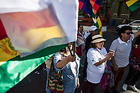 La Paz, Bolivia<br /> Saturday November 16, 2019.<br /> People march in downtown La Paz requesting peace in Bolivia.  After the October 20 presidential elections and resignation of President Evo Morales, there is a lot of protests in many regions of Bolivia.
