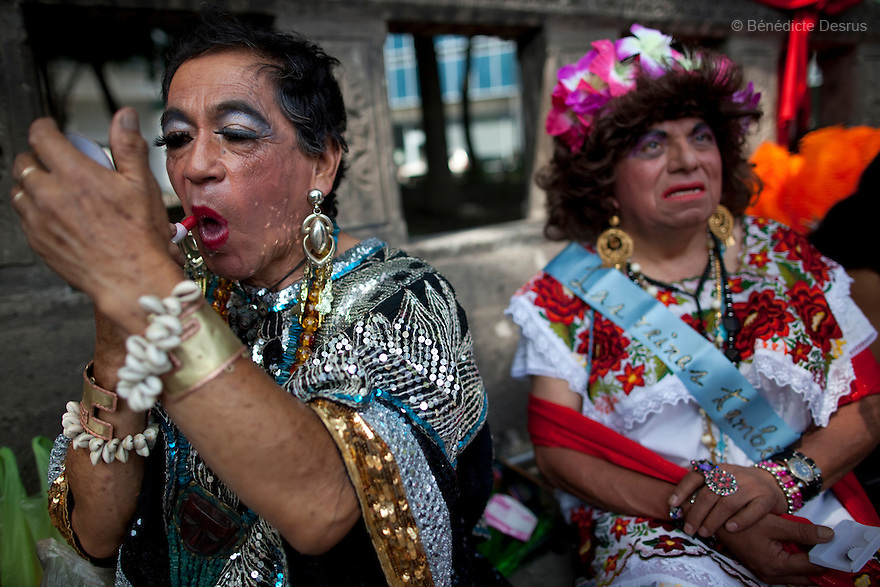 2 June 2012 - Mexico City, Mexico - Two transvestites put make up on during the Gay Pride Parade in Mexico City. People take part in the annual gay pride parade in Mexico City (known in Mexico as Marcha del orgullo LGBTQI). Mexico's high-altitude capital city has a huge and active gay population. The increasingly popular Mexico City Gay Pride is helping to heighten the LGBT community's visibility. The LGBT community has been gaining some rights in the first years of the 21st century. On 2003, the Federal Law to Prevent and Eliminate Discrimination was passed. In November 2006, the Law for Coexistence Partnerships was enacted in the Federal District. On March 2010, Mexico became the first Latin American country to allow same-sex marriage by non-judicial means. Photo credit: Benedicte Desrus