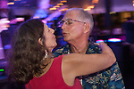 A romantic dance during Ulele's customer appreciation party.