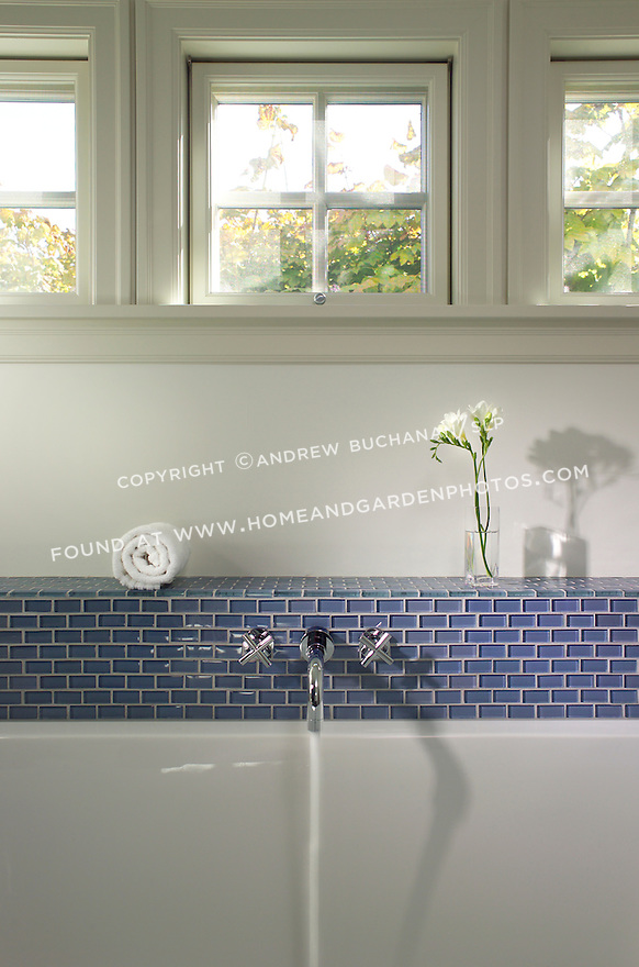 Blue decorative tile surrounds a white bathtub. this image is available through an alternate architectural stock image agency, Collinstock located here: http://www.collinstock.com