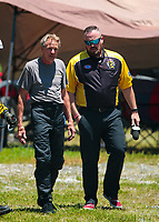 Jun 16, 2018; Bristol, TN, USA; NHRA pro stock driver Tommy Lee (left)walks away alongside NHRA announcer Brian Lohnes after crashing into the catch net in the sand trap after his parachutes failed to deploy during qualifying for the Thunder Valley Nationals at Bristol Dragway. Mandatory Credit: Mark J. Rebilas-USA TODAY Sports