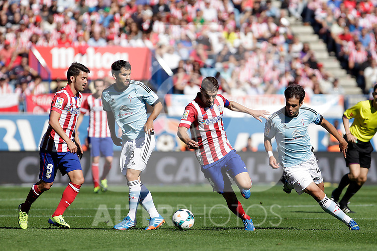 Atletico de Madrid´s Villa (L) and Koke (2R) and Celta de Vigo´s Alex Lope (2L) and Oubiña (R) during La Liga 2013/14 match. October 06, 2013. (ALTERPHOTOS/Victor Blanco)