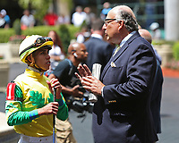 HALLANDALE BEACH, FL - MARCH 31:  Trainer Christophe Clement discusses strategy with jockey Irad Ortiz Jr,  before winning the Cutler Bay Stakes. Scenes from  Florida Derby Day at Gulfstream Park on March 31, 2017 in Hallandale Beach, Florida. (Photo by Liz Lamont/Eclipse Sportswire/Getty Images)