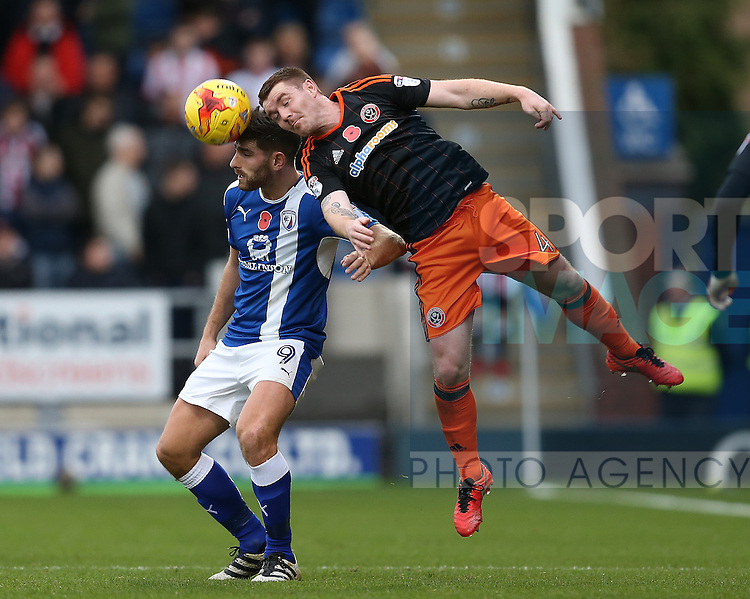 John Fleck of Sheffield Utd and Ched Evans of Chesterfield battle for possession during the English League One match at the Proact Stadium, Chesterfield. Picture date: November 13th, 2016. Pic Simon Bellis/Sportimage