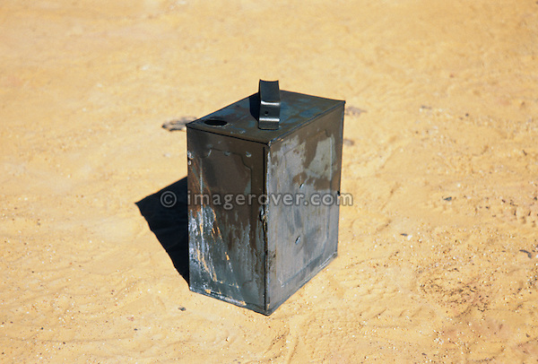 Africa, Libya, Fezzan. World War Second petrol can at a battlefield in a valley of the Gebel Sherif mountains southwest of Kufra. During Second World War on January 31 1941 the Long Range Desert Group was attacked by the Italian Compagnie Sahariane. Libyen 1999/2000.<br /> <br />  --- No releases available. Automotive trademarks are the property of the trademark holder, authorization may be needed for some uses.<br /> <br />  --- INFO: The Long Range Desert Group (LRDG) was a reconnaissance and raiding unit of the British Army during the Second World War. Originally called the Long Range Patrol Unit (LRP), the unit was founded in Egypt in June 1940 by Major Ralph A. Bagnold. Bagnold was assisted by Captain Patrick Clayton and Captain William Shaw. At first the majority of the men were from New Zealand, but they were soon joined by Rhodesian and British volunteers, whereupon new sub-units were formed and the name was changed to the better-known Long Range Desert Group (LRDG).<br /> <br /> The LRDG vehicles were mainly two wheel drive, chosen because they were lighter and used less fuel than four wheel drive. They were stripped of all non-essentials, including doors, windscreens and roofs. They were fitted with a bigger radiator, a condenser system, built up leaf springs for the harsh terrain, wide, low pressure desert tyres, sand mats and channels etc. Initially the LRDG patrols were equipped with one CMP Ford 15 cwt F15 truck for the commander, while the rest of the patrol used up to 10 Chevrolet 30 cwt WB trucks.<br /> <br /> On 31 January 1941 'T' Patrol commanded by Captain Patrick Clayton was attacked by the Compagnia Autosahariana di Cufra, an Italian unit similar to the LRDG, in the Gebel Sherif valley south of Cufra, Libya. The LRDG had one man killed and three men captured, and three of the eleven trucks were destroyed during the battle. The Italians losses were five killed and three wounded, and one truck was abandoned.