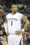 Venoy Overton, University of Washington guard, looks to the bench for instruction during the Huskies Pac-10 conference showdown with arch-rival Washington State at Bank of America Arena in Seattle, Washington, on March 7, 2009.  The Huskies defeated the Cougars in a tight contest, 67-60