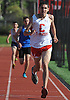 Connetquot junior Liam Ward legs out a victory in the 800 meter race during a Suffolk County boys' track and field meet against Middle Country at Connetquot High School on Thursday, May 14, 2015.<br /> <br /> James Escher