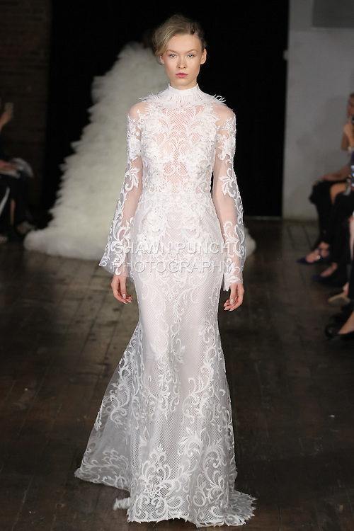 "Model walks runway in an ""Enchanted"" bridal gown from the Alyne by Rita Vinieris Fall 2017 collection on October 7th, 2016 during New York Bridal Fashion Week."