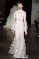 """Model walks runway in an """"Enchanted"""" bridal gown from the Alyne by Rita Vinieris Fall 2017 collection on October 7th, 2016 during New York Bridal Fashion Week."""