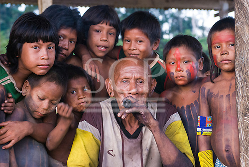 Pará State, Brazil. Aldeia Pukararankre (Kayapo). Cacique Kadjunhoro Kayapo with the village boys.