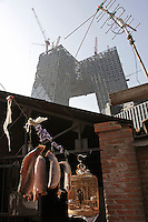 The new CCTV Tower and its hutong vicinities in Beijing, China. At 54 stories tall and more than $600 million headquarters Ole Scheeren, the German architect-in-charge of the new CCTV said that it is about inovation rather than height..