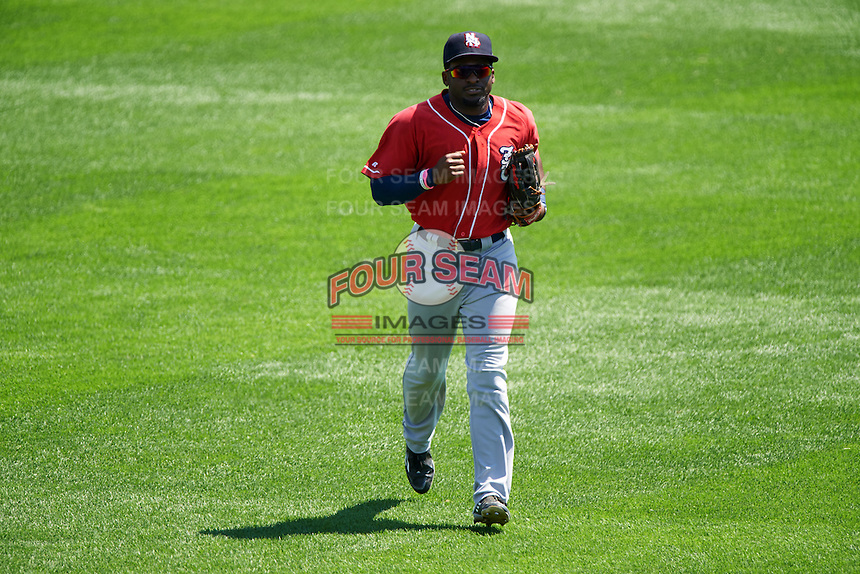 New Hampshire Fisher Cats left fielder Dwight Smith Jr. (25) jogs to the dugout in between innings during a game against the Reading Fightin Phils on June 6, 2016 at FirstEnergy Stadium in Reading, Pennsylvania.  Reading defeated New Hampshire 2-1.  (Mike Janes/Four Seam Images)