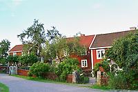 The red houses on the road in Bullerbyn Mellangården, The Middle House. Sörgården, The South House. Norrgården, The North House. The original location where Astrid Lindgren's story on Bullerbyn was filmed. In reality called Sevedstorp. Smaland region. Sweden, Europe.