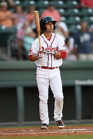 Second baseman Steven Reveles (18) of the Greenville Drive bats in a game against the Rome Braves on Wednesday, May 31, 2017, at Fluor Field at the West End in Greenville, South Carolina. Greenville won, 7-1. (Tom Priddy/Four Seam Images)