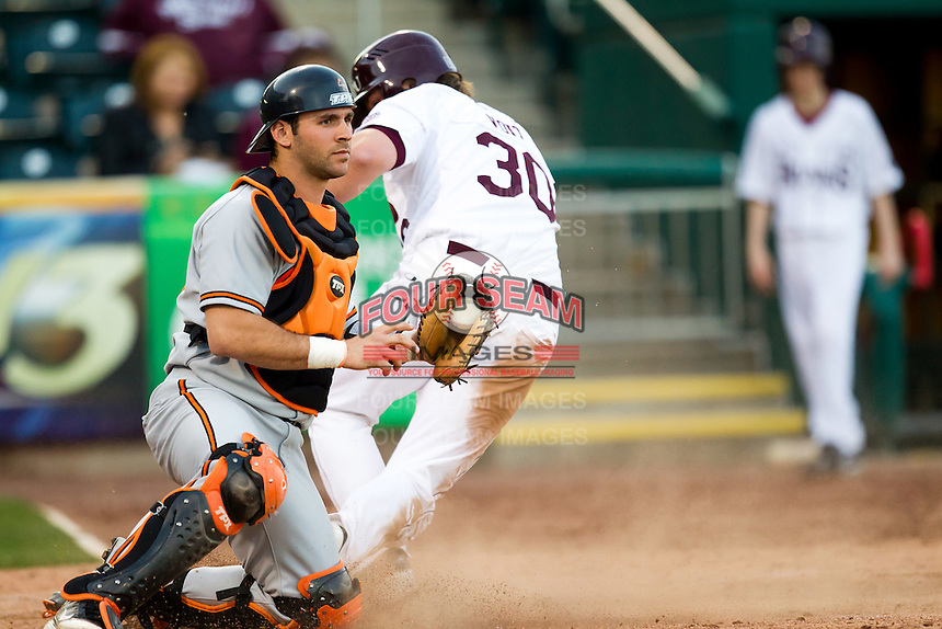 Jared Womack (55) of the Oklahoma State Cowboys holds a ball thrown to home plate as Luke Voit (30) of the Missouri State Bears slides in during a game against the Missouri State Bears at Hammons Field on March 6, 2012 in Springfield, Missouri. (David Welker / Four Seam Images)