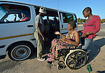 Delina Nleya prepares to climb into a kombi--a van used as public transportation--near her home in Bulawayo, Zimbabwe. With her is her daughter Nkazimulo, 16. People in wheelchairs in Zimbabwe are often ignored by kombi drivers, or they're charged double to bring their wheel chair along. Nleya suffered a spinal cord injury and uses a wheelchair provided by the Jairos Jiri Association with support from CBM-US.