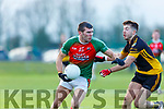 Kevin McCarthy Kilcummingoes past Dale Dawson Fermoy during the Munster Intermediate Championship in Mallow on Sunday