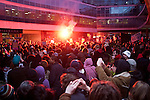 As darkness falls at Conservative Party Headquarters on Millbank, hundreds of protesters, still crammed into the courtyard, are illuminated by a distress flare held aloft in the crowd. 10/11/10