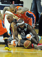 Paora Winitana, Kevin Braswell (Sharks, 12) and Kareem Johnson (42) fight for the ball during the national basketball league semifinal between Bay Hawks and Southland Sharks at TSB Bank Arena, Wellington, New Zealand on Friday, 4 July 2014. Photo: Dave Lintott / lintottphoto.co.nz
