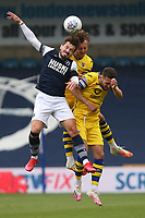 Ben Wilmot of Swansea City rises above Tom Bradshaw of Millwall during Millwall vs Swansea City, Sky Bet EFL Championship Football at The Den on 30th June 2020