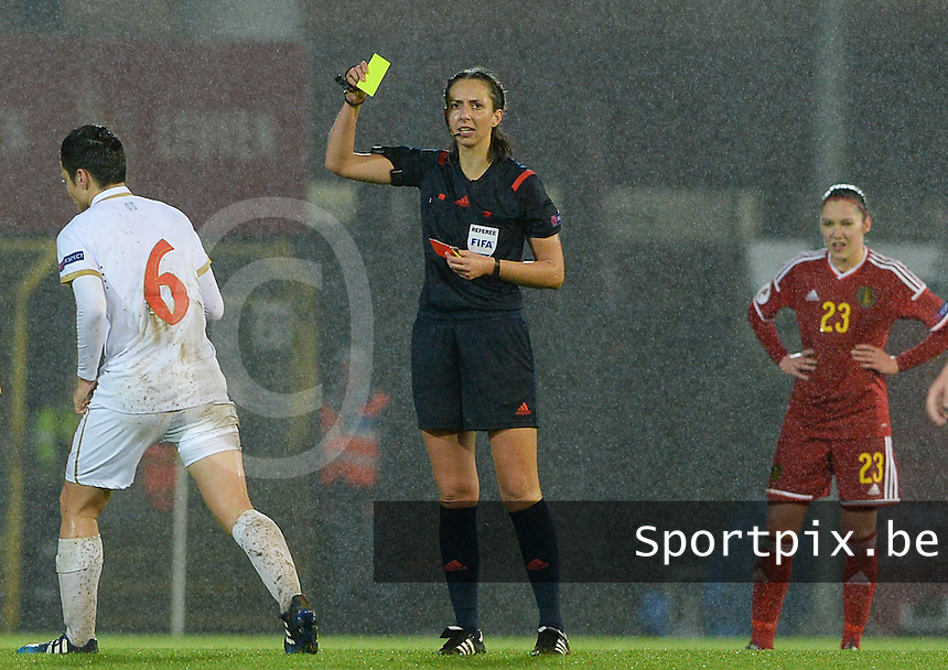 20151130 - LEUVEN ,  BELGIUM : German referee Marija Kurtes pictured giving a yellow card during the female soccer game between the Belgian Red Flames and Serbia , the third game in the qualification for the European Championship in The Netherlands 2017  , Monday 30 November 2015 at Stadion Den Dreef  in Leuven , Belgium. PHOTO DAVID CATRY