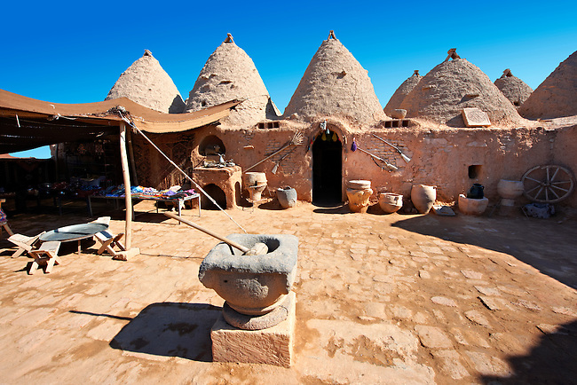 """Pictures of the beehive adobe buildings of Harran, south west Anatolia, Turkey.  Harran was a major ancient city in Upper Mesopotamia whose site is near the modern village of Altınbaşak, Turkey, 24 miles (44 kilometers) southeast of Şanlıurfa. The location is in a district of Şanlıurfa Province that is also named """"Harran"""". Harran is famous for its traditional 'beehive' adobe houses, constructed entirely without wood. The design of these makes them cool inside. 23"""