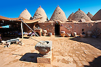 "Pictures of the beehive adobe buildings of Harran, south west Anatolia, Turkey.  Harran was a major ancient city in Upper Mesopotamia whose site is near the modern village of Altınbaşak, Turkey, 24 miles (44 kilometers) southeast of Şanlıurfa. The location is in a district of Şanlıurfa Province that is also named ""Harran"". Harran is famous for its traditional 'beehive' adobe houses, constructed entirely without wood. The design of these makes them cool inside. 23"