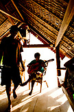INDONESIA, Mentawai Islands, Kandui Surf Resort, guitarist performing at resort