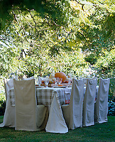 An outdoor table laid for a meal with an autumn theme