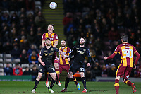 Tony McMahon of Bradford City beats Michael Jacobs of Wigan in the air during the Sky Bet League 1 match between Bradford City and Wigan Athletic at the Northern Commercial Stadium, Bradford, England on 14 March 2018. Photo by Thomas Gadd.