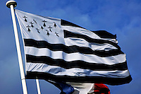 Breton and French flags flying in the wind, Brittany, France.