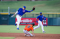 AZL Cubs second baseman Fidel Mejia (76) attempts to apply a tag to Aaron Bond (38) during a game against the AZL Giants on July 17, 2017 at Sloan Park in Mesa, Arizona. AZL Giants defeated the AZL Cubs 12-7. (Zachary Lucy/Four Seam Images)