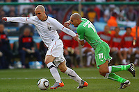 Michael Bradley (left) of USA and Rafik Djebbour (R) of Algeria. USA defeated Algeria 1-0 in stoppage time in the 2010 FIFA World Cup at Loftus Versfeld Stadium in Pretoria, Sourth Africa, on June 23th, 2010.