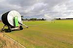 Rainstar irrigator crop sprayer field of grass turf, Alderton, Suffolk, England, UK