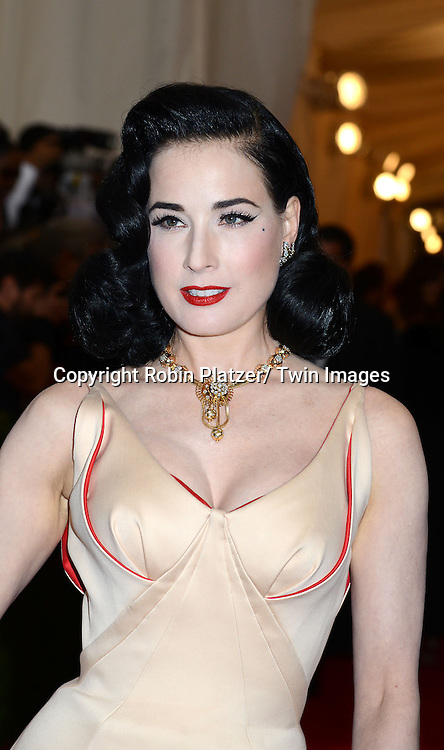 Dita Von Teese attends the Costume Institute Benefit on May 5, 2014 at the Metropolitan Museum of Art in New York City, NY, USA. The gala celebrated the opening of Charles James: Beyond Fashion and the new Anna Wintour Costume Center.