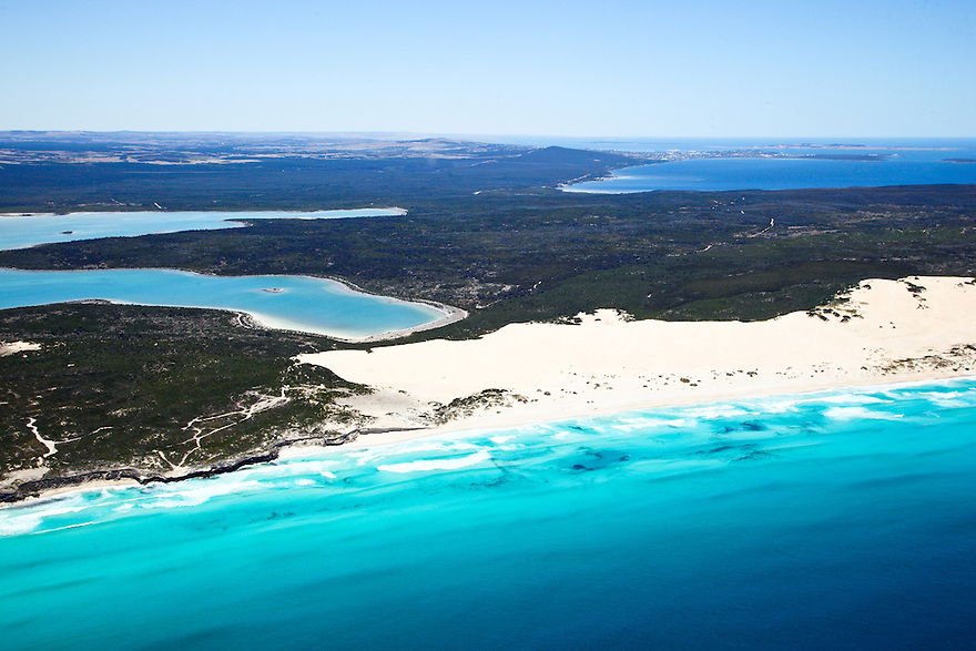 Aerial photo of Sleaford Bay. Lincoln National Park. South Australia. Sleaford Mere in the background and the city of Port Lincoln in the distant background.