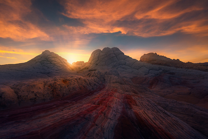 A colorful sunset over the otherworldly striated sandstone formations in the Arizona/Utah desert.