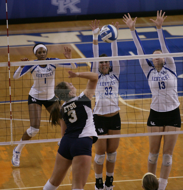 Senior Christine Hartmann (32) and Redshirt Freshman Kayla Tronick (13) go up for a block during the University of Kentucky vs East Tennessee State University in the first round of the NCAA Volleyball Tournament in Lexington, Ky., on, 11/30/2012,. Photo by Jared Glover | Staff