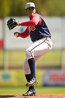 Rome Braves starting pitcher Jairo Cuevas (#45) winds up versus Kannapolis at Fieldcrest Cannon Stadium in Kannapolis, NC, Tuesday, April 18, 2006.  Cuevas struck out 9 Intimidators in the Braves 6-4 victory.