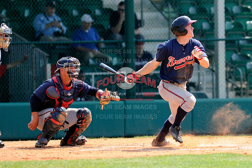 Outfielder Stephen Gaylor (38) of the Atlanta Braves farm system in a Minor League Spring Training intrasquad game on Wednesday, March 18, 2015, at the ESPN Wide World of Sports Complex in Lake Buena Vista, Florida. The catcher is Tanner Murphy. (Tom Priddy/Four Seam Images)