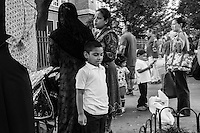 Parents pick up their sons up from school in Jackson Heights, Queens, New York.
