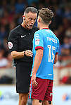 Referee Darren Deadman speaks to Harry Toffolo of Scunthorpe Utd during the English League One match at Glanford Park Stadium, Scunthorpe. Picture date: September 24th, 2016. Pic Simon Bellis/Sportimage