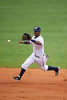 Montgomery Biscuits shortstop Hector Guevara (13) fields a ground ball during a game against the Tennessee Smokies on May 25, 2015 at Riverwalk Stadium in Montgomery, Alabama.  Tennessee defeated Montgomery 6-3 as the game was called after eight innings due to rain.  (Mike Janes/Four Seam Images)