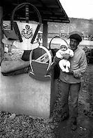 Montenegro  Novembre 2000.Campo profughi di Konik 1.Fami Adici,etnia rom ,52 anni falegname viene da Kosovo Polje, sposato  con 5 figli e 2 cognate un nipote, costruisce culle che vende a 10EUR