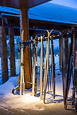 USA, Wyoming, Yellowstone National Park, cross country skiis and poles rest in a rack outside the Snow Lodge at Old Faithful, Upper Geyser Basin