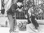 FILMBILD / T: Lichter der Gro??stadt / City Lights D: Charlie Chaplin, Virginia Cherill R: Charlie Chaplin P: USA J: 1931 PO: Szenenbild RU: Tragikom??die DA:  Filmstill // HANDOUT / EDITORIAL USE ONLY! / Please note: Fees charged by the agency are for the agency??s services only, and do not, nor are they intended to, convey to the user any ownership of Copyright or License in the material. The agency does not claim any ownership including but not limited to Copyright or License in the attached material. By publishing this material you expressly agree to indemnify and to hold the agency and its directors, shareholders and employees harmless from any loss, claims, damages, demands, expenses (including legal fees), or any causes of action or allegation against the agency arising out of or connected in any way with publication of the material.