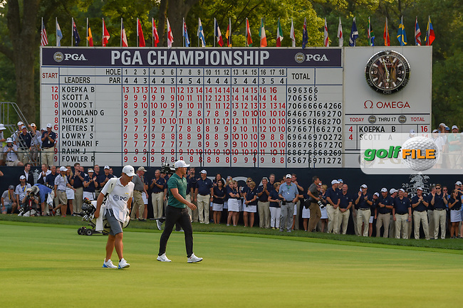 Brooks Koepka (USA) walks past the leaderboard with his name at the top as he approaches the green on 18 during 4th round of the 100th PGA Championship at Bellerive Country Club, St. Louis, Missouri. 8/12/2018.<br /> Picture: Golffile   Ken Murray<br /> <br /> All photo usage must carry mandatory copyright credit (© Golffile   Ken Murray)