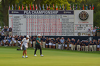 Brooks Koepka (USA) walks past the leaderboard with his name at the top as he approaches the green on 18 during 4th round of the 100th PGA Championship at Bellerive Country Club, St. Louis, Missouri. 8/12/2018.<br /> Picture: Golffile | Ken Murray<br /> <br /> All photo usage must carry mandatory copyright credit (&copy; Golffile | Ken Murray)