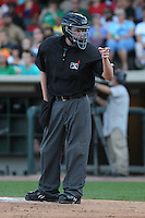 Home plate umpire Clay Park points at a dugout during a game between the Dayton Dragons and Lake County Captains at Fifth Third Field on June 25, 2012 in Dayton, Ohio. Lake County defeated Dayton 8-3. (Brace Hemmelgarn/Four Seam Images)